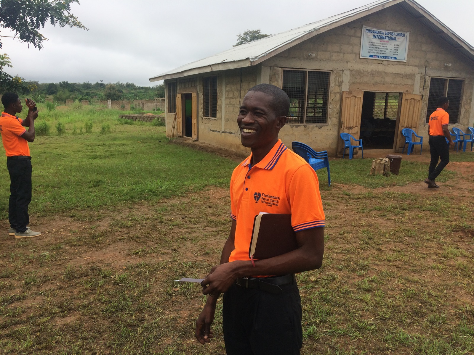 Pastor Rexford Aning. Church building and property in the background.